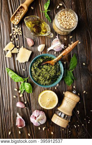Flat Lay View At Food Background Of Genovese Pesto Sauce And Its Ingredients On Wooden Kitchen Table