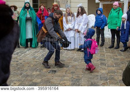 Lviv, Ukraine January 7,2019,girl Gives A Donation In The Square For The Nativity Scene Performing P