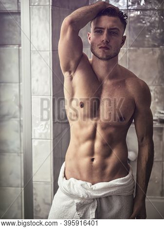 Shirtless Muscular Handsome Young Man After Shower Or Bath In The Bathroom