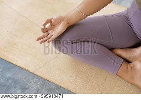 Girl Sitting In The Lotus Position On Organic Mat. Padmasana