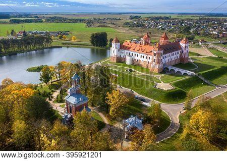 Belarus Famous Mir Castle In The Minsk Region. Belarus Sightseeing Aerial View In Colorful Bright Au