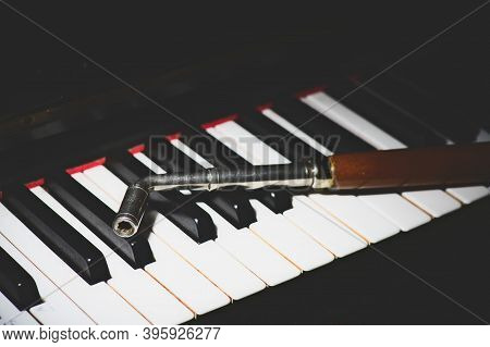 Piano Keyboard With A Tuner Backed Object