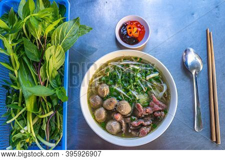 Bowl Of Fresh-cooked Pho Beef Noodle Served With Vegetables