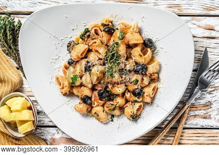 Conchiglie Rigate Italian Pasta With Tomato, Olives, Capers, Anchovies. White Background. Top View