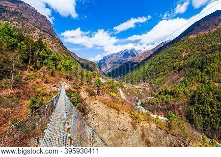 Bridge Through The River In Everest Or Khumbu Region In Himalaya Mountains, Nepal