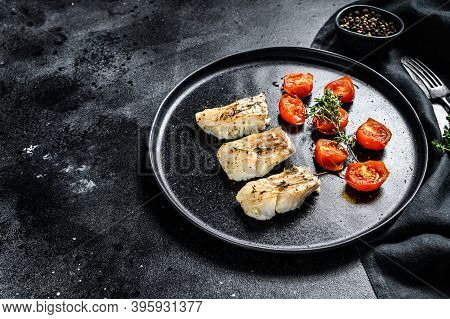 Baked Cod Fish Fillet With . Black Background. Top View. Copy Space