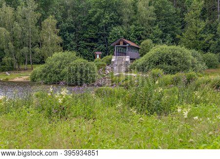 Idyllic Waterside Scenery Including A Roofed Bridge Around Wiesenfelden In The Bavarian Forest At Su