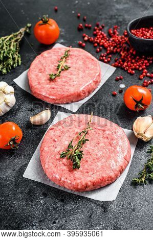 Burger Patties, Raw Fresh Ground, Mince Meat. Black Background. Top View