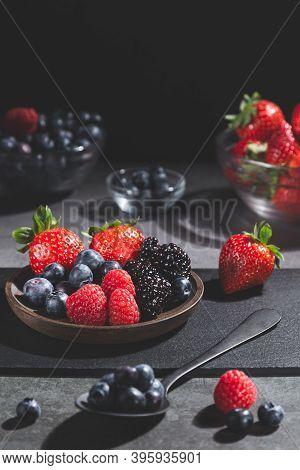 Mixed Berries On Dark Background. Vertical Format.