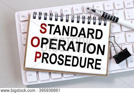 Standard Operation Prosedure, Sop. Text On White Paper On Gray Background.