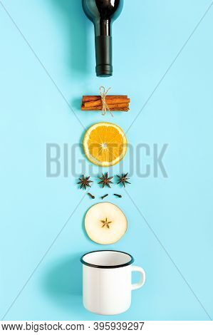 Mulled Wine Ingredients, Still Life On Blue Background. Bottle Of Wine, Cinnamon Sticks, Slices Of O