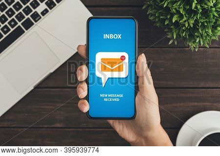 Creative Collage Of Young Woman Hand Checking Email Inbox On Mobile Phone At Office Desk, Receiving