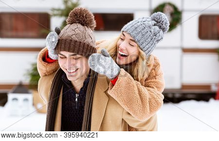 Young Couple In Love Having Fun Outdoors At Winter Day, Romantic Man And Woman In Woolen Hats Playin