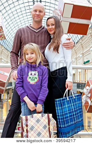 family is shopping in a store