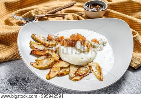 Burrata Cheese With Baked Pear And Pear Marmalade. Gray Background. Top View.
