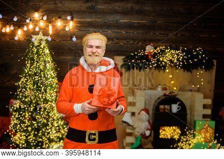 Santa Claus With Present Box. Portrait Of Santa Man. Christmas Decorations. Smiling Santa Claus. Mer