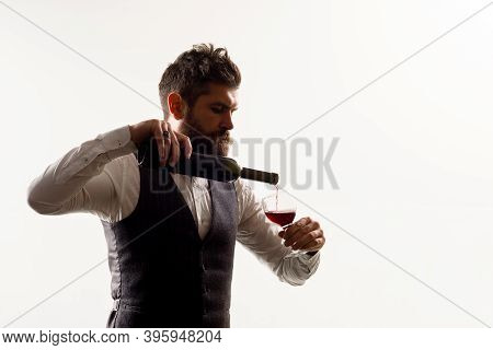 Glass Of Wine. Red Wine. Man In Suit Drinks Wine. Alcohol. Wine Bottle. Man With Bordeaux. Tasting A