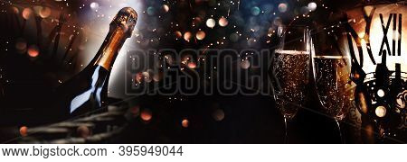 Greetings For A New Year 2021. Festive New Years Eve Background With Champagne And Clock. Concept Fo