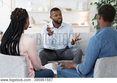 Family Psychotherapy. African American Couple Listening To Counselors Advices During Therapy Session