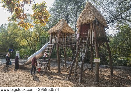 Ljubljana, Slovenia, October 2020: Parents Play With Their Children At The Playground At The Ljublja