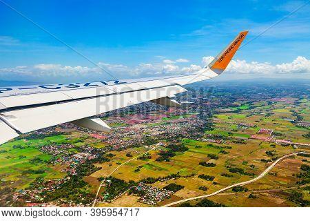 Manila, Philippines - February 23, 2013: Cebu Pacific Airplane Wing Above The Manila City Suburbs In