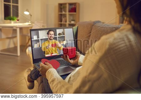 Young Loving Happy Couple Showing Decorative Red Heart And Present To Each Other During Online Video