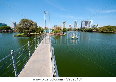 COLOMBO - APRIL 13: Bridge to Children`s Park in Beira Lake on April 13, 2012 in Colombo, Sri Lanka. Colombo is the largest city and the commercial, industrial and cultural capital of Sri Lanka.