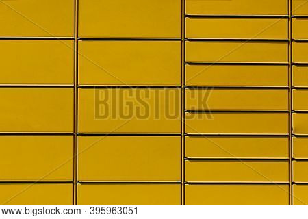A Metal Box Divided Into Smaller And Larger Pockets In Which Parcels From Senders And Recipients Are