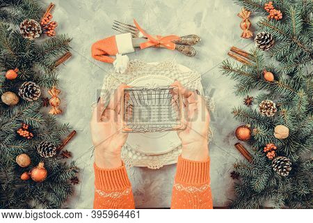 Christmas Gray Grunge Background, Fir Twigs, Berries, Snowflakes, Baubles, Top View. New Year Table