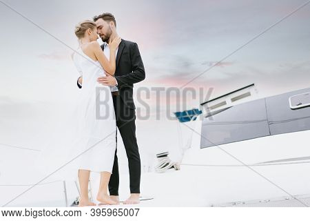 Portrait Of Young Caucasian Couple In Love Relaxing On Luxury Yacht In The Sea. People Celebrating W