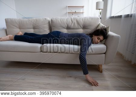 Tired Exhausted Asian Woman Sleeping On Couch At Home