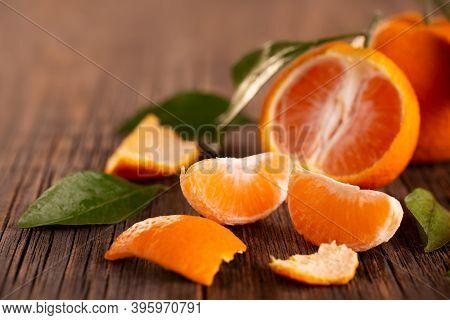 Ripe Tangerine On A Wooden Table. Peeled Tangerine. Tangerine Fruit Close-up.