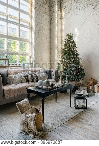 Vertical Photo Of Cozy Living Room With Soft Cushions On Comfortable Couch And New Year Decoration A