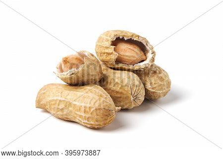 Raw Peanuts Isolated On White. Heap Of Groundnuts In A Nutshell