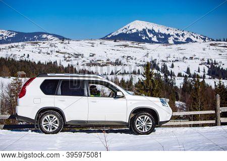 Suv Car Travel. Winter Mountains. Road Trip