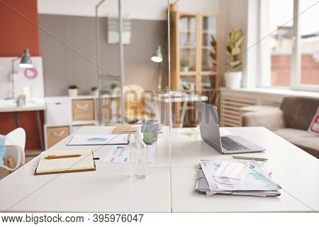 Background Image Of Two Office Desks Separated By Glass Pane At Post Pandemic Workplace, Copy Space