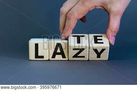 Late And Lazy. Male Hand Flips Wooden Cubes And Changes The Word 'lazy' To 'late' Or Vice Versa. Bea