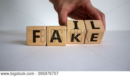 Fail Fake. Male Hand Flips Wooden Cubes With Words 'fail, Fake' On Beautiful White Background, Copy