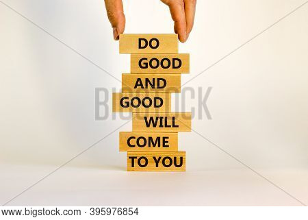 Concept Of Karma Motivational Words. Wooden Blocks On The Stack Of Wooden Blocks. Words 'do Good And