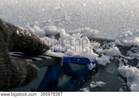 Ice Crystals In Sunlight On A Cold Winter Morning On A Windshield Of A Car Removed With A Plastic Ic