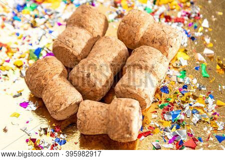 Close-up Of Champagne Corks On A Background Of Multicolored Confetti.  Selective Focus