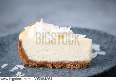 Slice Of Vegan Coconut Cheesecake On A Plate. Coconut Cashew Cheesecake