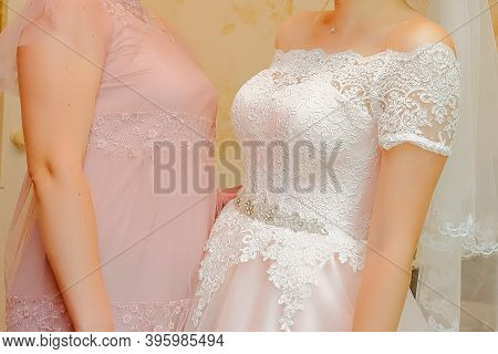 Girl In A Beautiful Lace Dress. Bride And Boyfriend, Two Beautiful Young Girls