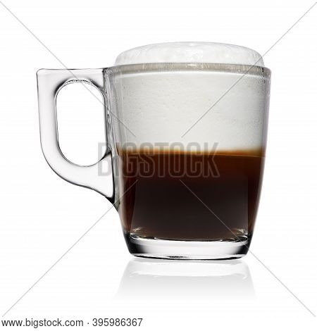 Transparent Glass Cup Of Espresso Macchiato Coffee With Milk Foam Isolated On White Background.