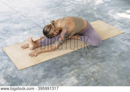 Woman Practicing Advanced Yoga On Organic Mat. Series Of Yoga Poses. Tropical Background