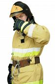 Firefighter protects the face with one hand. Isolated on white background poster