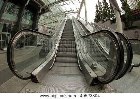 Moving escalator stairs