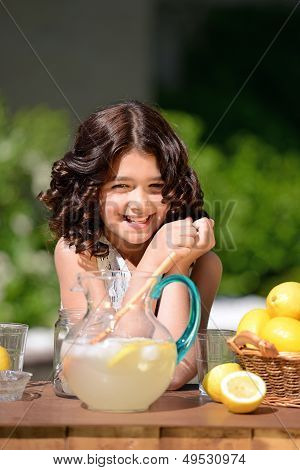 happy girl at lemonade stand