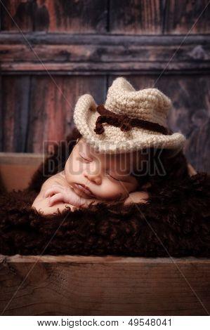 Newborn Baby Boy Wearing A Cowboy Hat