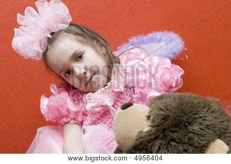 Little Girl Sitting On Her Teddy Bear